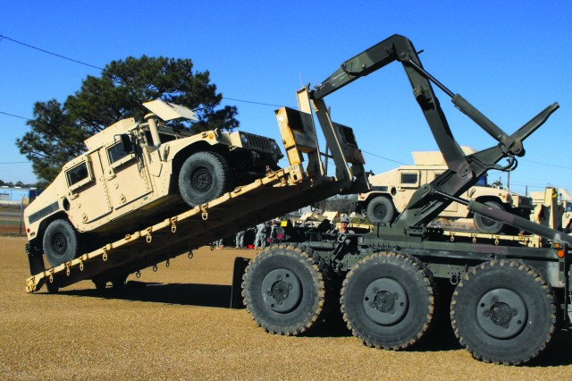 The 154th Transportation Company and 96th Transportation Company, both of the 4th Sustainment Brigade, at Fort Hood, Texas, were tasked with bringing a 2.5-ton crane and a large generator to Fort Polk, La., via heavy equipment transports, or HETs. The HET drivers then returned to Fort Hood with Humvees that were being permanently transferred between the installations. The Fort Hood drivers were all newly trained and this mission helped them become more familiar with the trucks and their loading procedures.