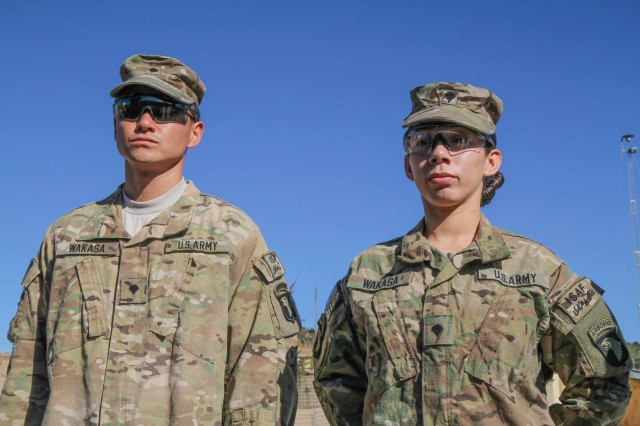 "Sgt. Lizeth Wakasa (right), a food service specialist assigned to Headquarters Company, 3rd Battalion, 187th Infantry Regiment, 3rd Brigade Combat Team ""Rakkasans,"" 101st Airborne Division (Air Assault), stands proudly by her husband Spc. David Wakasa, also a food service specialist with Headquarters, 3-187, at Combat Outpost Bowri Tana, Afghanistan, Dec. 1, 2012. The Wakasas have taken every step of their military career together and have recently been selected to become part of the Pentagon's special food staff."