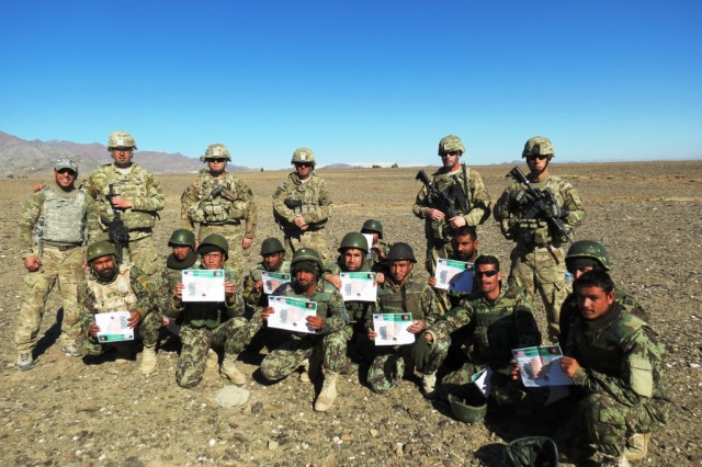 After demonstrating their abilities during a combat engineer course Afghan soldiers from the 4th Kandak, Engineer Coy, Afghan National Army, were awarded certificates of completion by their mentors from the 258th Mobile Combat Engineer Training Team, Task Force Prowler, near Camp Clark, Afghanistan, Dec. 20, 2012. The Afghan National Security Forces participated in a two-week course in which soldiers learned principle combat engineer skills. In order to graduate, the soldiers had to demonstrate proficiency in handling explosives, neutralizing booby traps, breaching obstacles and combat medical tasks.
