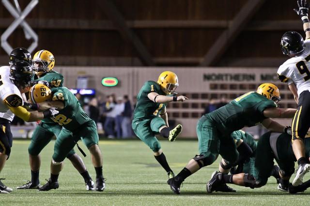 Rockne Belmonte, an Army ROTC Cadet and kicker for Northern Michigan University, kicks a field goal earlier this season.