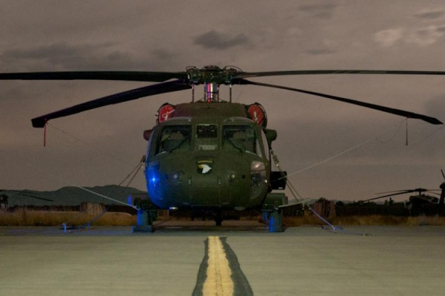 A UH-60 Black Hawk helicopter waits for its next mission on Forward Operating Base Salerno, Afghanistan, Oct. 22, 2012. (U.S. Army Photo by Sgt. Duncan Brennan, 101st CAB public affairs)