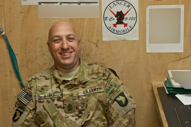 First Sgt. Tommy Daigle, B Company, 5th Battalion, 101st Combat Aviation Brigade, cracks jokes in his office at Forward Operating Base Fenty, Afghanistan, Dec. 11, 2012. (U.S. Army photo by Sgt. Duncan Brennan)