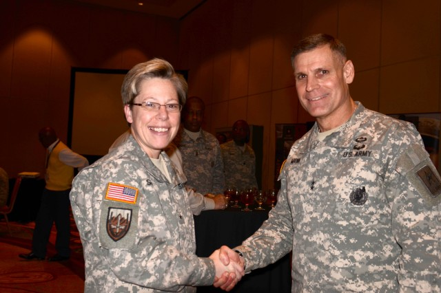 Brig. Gen. Tammy Smith and Maj. Gen. David L. Mann greet before dinner at the Marriott Rivercenter Hotel in San Antonio Jan. 2. The dinner provided a chance for networking with other service members and public figures.