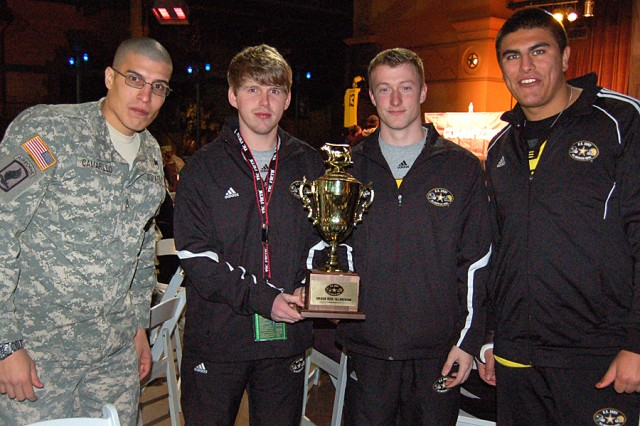 Army Recruiter Staff Sgt. David Camarillo meets with his All-American team Joseph VanScoi, Caleb White and Kylie Fitts, during a Soldier Hero dinner event. VanScoi and White are selected band members for the All-American Band. Fitts is No. 93 on the West Team.