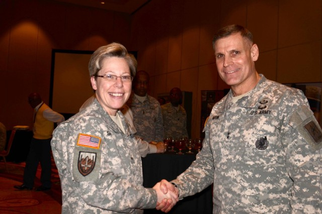 Brig. Gen. Tammy Smith and Maj. Gen. David L. Mann greet before dinner at the Marriott Rivercenter Hotel in San Antonio, Jan. 2, 2013. The dinner provided a chance for networking with other service members and public figures.
