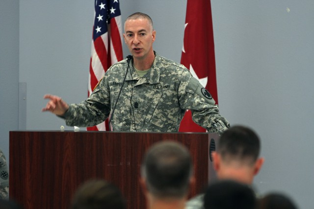 """Command Sgt. Maj. James Lambert, senior enlisted leader, U.S. Army Reserve, speaks about the future of the force Jan. 3 during a town hall at the James E. Rudder U.S. Army Reserve Center. Lambert and  Lt. Gen. Jeffrey Talley, Chief of the Army Reserve and Commanding General of the U.S. Army Reserve Command, spoke about the Reserve as part of the """"total Army,"""" with plans to further integrate Reserve and active commands and other potential changes."""