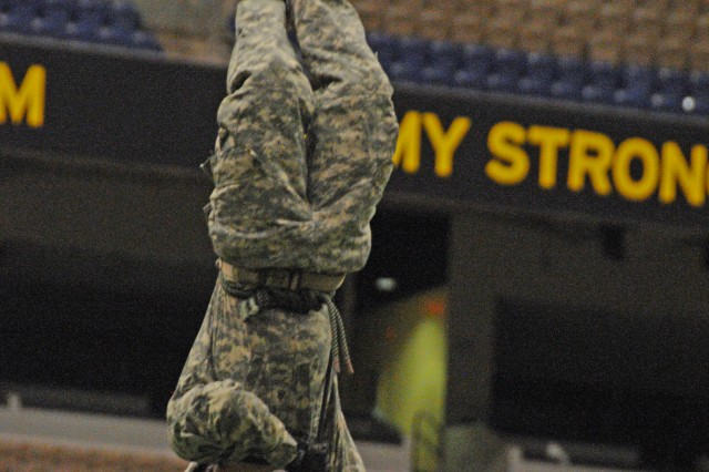 Staff Sgt. Eric Sutterfield descends using the Australian rappel. Nine rappelling instructors from the Air Assault School at Fort Campbell, Ky., practiced rappelling from the ceiling of San Antonio's Alamodome to the playing field, 180 feet below, Jan. 2, 2012. They were practicing for the U.S. Army All-American Bowl East-West game, which was played Jan. 5, 2013.