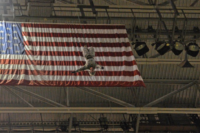 Staff Sgt. Eric Sutterfield descends using the Australian rappel. Nine rappelling instructors from the Air Assault School at Fort Campbell, Ky., practiced rappelling from the ceiling of San Antonio's Alamodome to the playing field, 180 feet below, Jan. 2, 2013. They were practicing for the U.S. Army All-American Bowl East-West game, which was played Jan. 5, 2013.