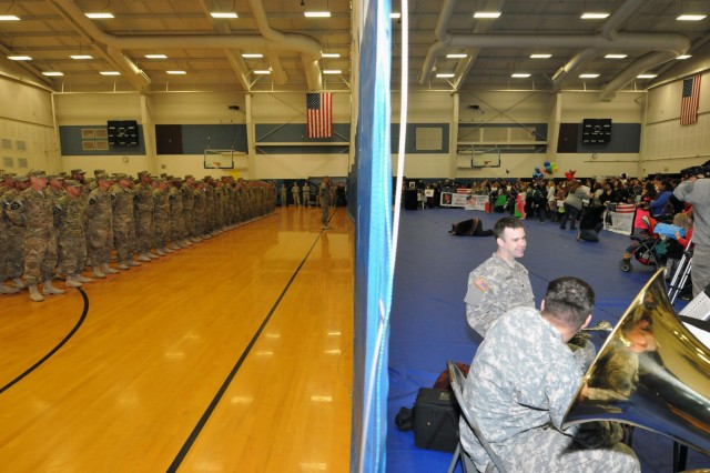 Friends and family on the right, tired combat troops on the left - the curtain in the gymnasium of JBLM's Wilson Fitness Center is all that remains of their nine-month deployment seperation. Soldiers of 2nd Infantry Brigade, 2nd Infantry Division, return from Afghanistan, Dec. 30, just in time for New Year's. (Photo by Sgt. Mark A. Cloutier)