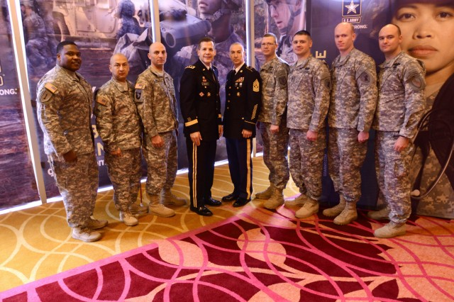 Staff Sgt. Dallas Pierce (fourth from right) meet with Lt. Gen. Jeffrey W. Talley (fourth from left), Chief of the U.S. Army Reserve and Commanding General of the Army Reserve, and Command Sgt. Maj. James Lambert (center), Command Sergeant Major of the Army Reserve, and other Army Reserve Soldier Heroes at the Grand Hyatt Hotel in San Antonio Jan. 4. Soldier Heroes are current Army Reserve Soldiers recognized for acts of valor during combat or recipients of a purple heart medal.