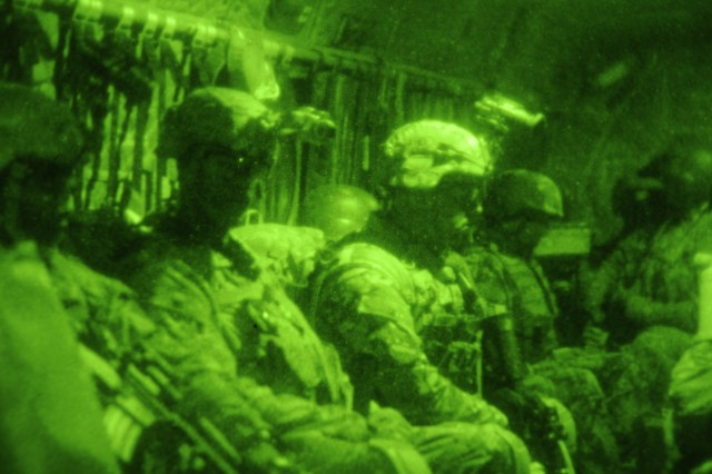 Soldiers from 2nd Battalion, 327th Infantry Regiment, 1st Brigade Combat Team, 101st Airborne Division (Air Assault), and Security Forces Assistance and Advisory Team-6 from 1st BCT, 101st Abn. Div., ride a CH-47 Chinook helicopter to the Nangalam Base, Afghanistan, Dec. 26, 2012. The Soldiers are heading to Nangalam in support of the Afghan National Army's resupply mission to Chapah Darah.