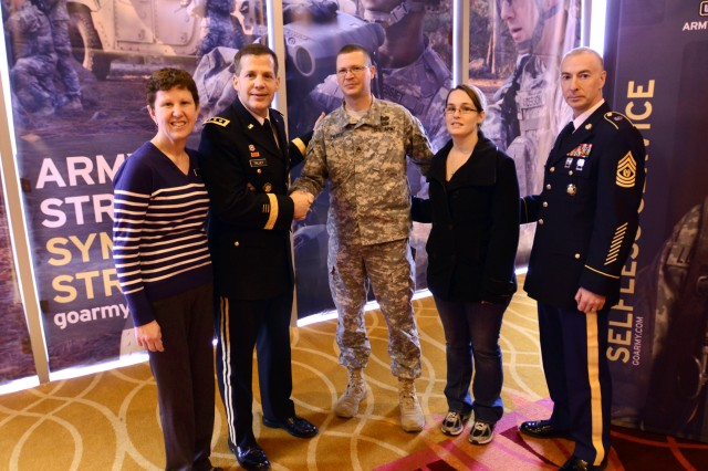 Staff Sgt. Dallas Pierce, a military policeman with the 200th Military Police Command, shakes hands with of Lt. Gen. Jeffrey W. Talley, chief of Army Reserve and commanding general, United States Army Reserve Command. Pierce's wife, Shannon, Linda Talley and Command Sgt. Maj. James Lambert were also present during the annual All-American Bowl high school football game held in San Antonio.