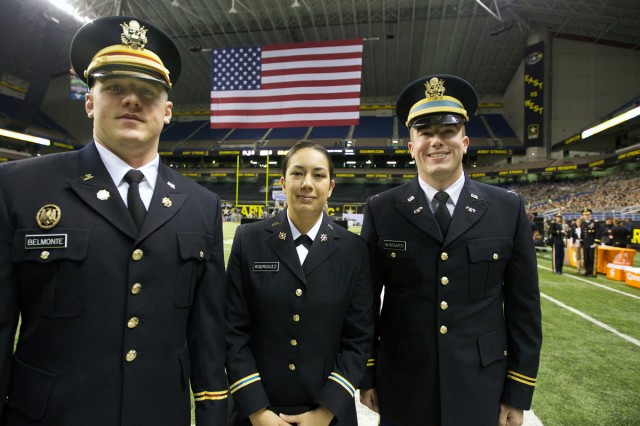 From left, newly commissioned 2nd Lt. Rockne Belmonte of Northern Michigan University, 2nd Lt. Ashley Rodriguez of St. Mary's University and 2nd Lt. James Wingard of the University of Texas-San Antonio, pose together on the Alamdome field just before their U.S. Army All-American Bowl pre-game commissioning ceremony, Jan. 5, 2013.