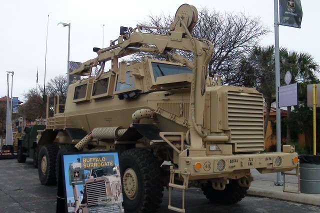 The Army Strong Zone showcased the Buffalo Mine-Protected Clearance vehicle, with 30-foot robotic arm and iron claw for ordinance disposal and route clearance. The claw is mounted with a camera and sensory equipment.