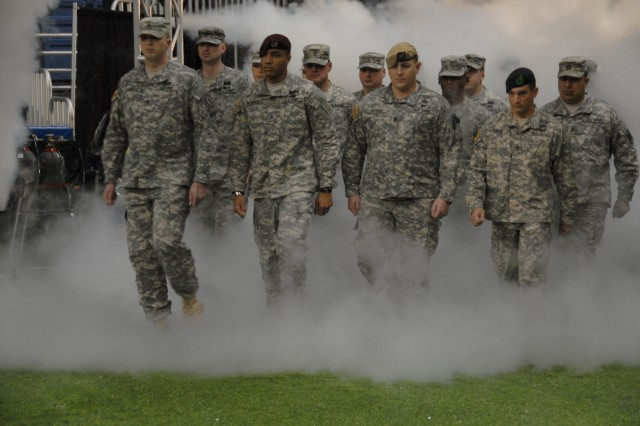 USASOC Soldiers lead the formation of Soldier heroes as they march on to the field during opening ceremonies of the Army All-American Bowl in San Antonio, Texas. (Photo by Cheryle Rivas, USASOC Public Affairs)