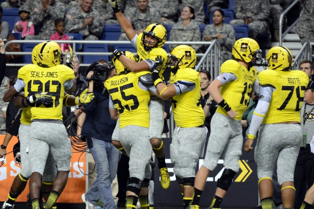 LSU-bound tight end DeSean Smith (hoisting football) of Lake Charles (La.) Barbe High School celebrates catching a two-point conversion pass from USC-bound quarterback Max Browne (No. 13) of Sammamish (Wash.) Skyline High School that gave the West an 8-7 lead with 6 minutes, 49 seconds remaining in the 2013 U.S. Army All-American Bowl, Jan. 5, 2013, at the Alamodome in San Antonio. The East rallied to win the game, 15-8.