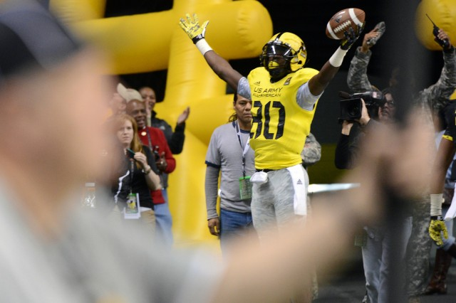 Texas A&M-bound wide receiver Derrick Griffin of Rosenberg (Texas) Terry High School celebrates his 16-yard touchdown reception from quarterback Max Browne of Sammamish (Wash.) Skyline High School that pulls West within 7-6 of the East in the 2013 U.S. Army All-American Bowl, Jan. 5, 2012, in San Antonio.