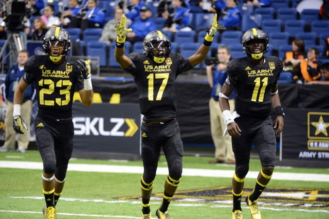 East wide receiver James Quick (No. 17) of Trinity High School in Louisville, Ky., celebrates catching the game-winning touchdown with teammates Tyler Boyd (23) of Clairton (Pa.) High School and Jeremy Johnson (11) of Montgomery (Ala.) Carver High School at the 2013 U.S. Army All-American Bowl, Jan 5, 2013, at the Alamodome in San Antonio. Quick's 34-yard touchdwon reception from Johnson gave the East a 13-8 lead with 3 minutes, 59 seconds remaining in the game. Quick, who had three receptions for 71 yards, also received the Pete Dawkins Game MVP award.