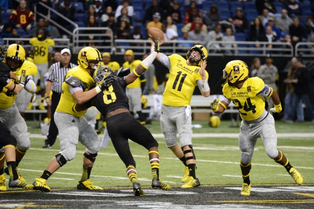 LSU-bound quarterback Hayden Rettig of Los Angeles Cathedral High School, who completed 3 of 11 passes for 13 yards, takes another deep shot as time winds down in the 2013 U.S. Army All-American Bowl, Jan. 5, 2013, at the Alamodome in San Antonio. East defensive lineman Al-Quadin Muhammad (No. 8) of Ramsey (Tenn.) Don Bosco Preparatory School applies pressure and Ohio State-bound Ezekiel Elliott (24) of St. Louis John Burroughs High School provides an option. The East won the game, 15-8.