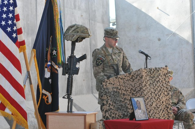 First Lt. Matthew Morgan, a platoon leader with 38th Engineer Company, Combined Task Force 4-2 (4th Stryker Brigade Combat Team, 2nd Infantry Division) speaks during the memorial service for his soldier, Pfc. Markie Sims, Jan. 4, here. Sims, a combat engineer and Citra, Fla., native, died Dec. 29 during combat operations in the Panjwa'i district of Afghanistan. (U.S. Army photo by Sgt. Kimberly Hackbarth, 4th SBCT, 2nd Infantry Division Public Affairs Office)