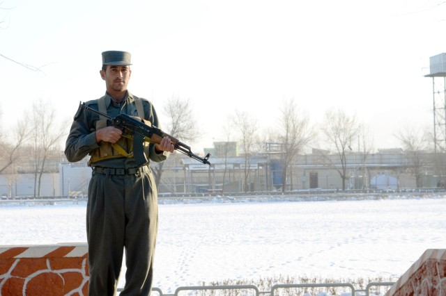 "KABUL PROVINCE, Afghanistan "" An Afghan Uniformed Police cadet stands watch at the Kabul Police Academy, Kabul, Afghanistan, while other cadets attend scheduled classes, Jan. 6, 2013. (U.S. Army photo by Staff Sgt. David J. Overson, 115th Mobile Public Affairs Detachment)"