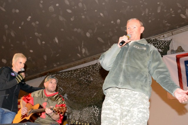 "Chairman of the Joint Chiefs of Staff, Gen. Martin E. Dempsey sings ""White Christmas"" with Kellie Pickler at the USO Holiday show at Bagram Air Field, Afghanistan, Dec. 15, 2012. (U.S. Army photo by Staff Sgt. David J. Overson, 115th Mobile Public Affairs Detachment)"