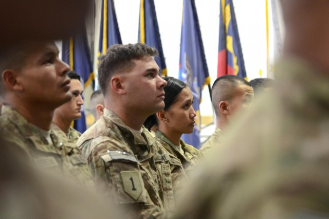 Soldiers who are deployed to Afghanistan in support of Operation Enduring Freedom wait to become naturalized citizens during a ceremony at Bagram Airfield, Afghanistan, Nov., 2, 2012.