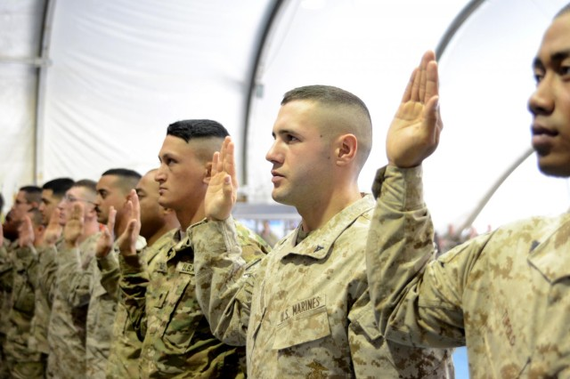 Servicemembers who are deployed to Afghanistan in support of Operation Enduring Freedom swear an oath to become naturalized citizens during a ceremony at Bagram Airfield, Afghanistan, Nov., 2, 2012.