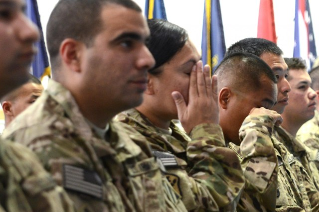 Soldiers who are deployed to Afghanistan in support of Operation Enduring Freedom are emotionally moved when they finally become naturalized citizens during a ceremony at Bagram Airfield, Afghanistan, Nov. 2, 2012.