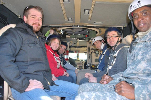Shown inside one of the test vehicles at the Aberdeen Test Center is (l to r): an ATC employee; Ashley Wade, Army Research Office; Eric Compton, Laboratory Operations (LABOPS); James Maley and Ryan Toonen, both Weapons and Materials Research Directorate (WMRD); and Sgt. Maj. Christopher Harris.