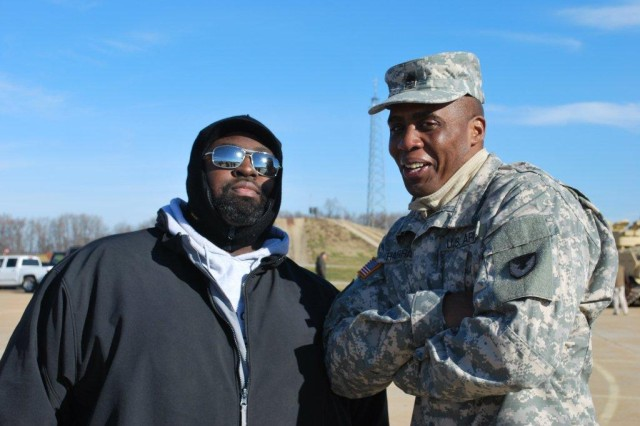Richard Thomas, Sensors and Electron Devices Directorate, and Sgt. Maj. Christopher Harris discuss the day's activities.