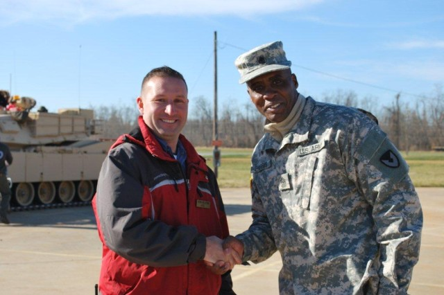 Sgt. Maj. Christopher Harris thanks Kevin Pelletier from the Aberdeen Test Center for supporting ARL's greening course by providing a tour and explaining what they do at ATC.
