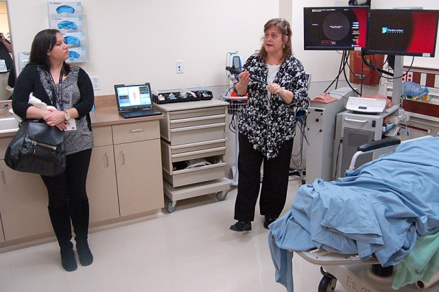 Cindy Wait explains the features of a bronchoscope model that physicians use for training at the Brooke Army Medical Center Simulation Center. Anna Gilmore, a premedicine student advisor at Emory Career Center in Atlanta, observes the bronchoscope demonstration.