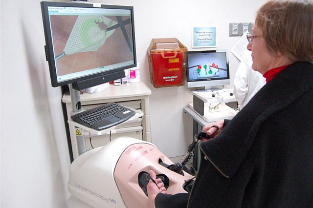 Gerrie Barnett, University of Utah director of undergraduate nursing program, performs a virtual laparoscopy at the Simulation Center of the Brooke Army Medical Center in San Antonio.