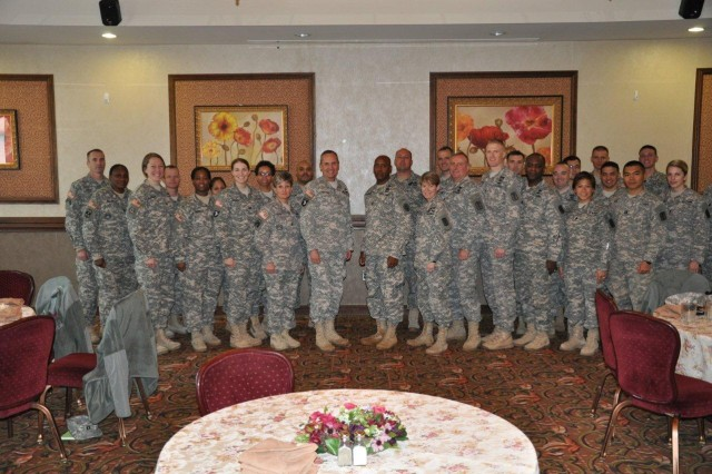 DAEGU, Korea -- Brig. Gen. Dennis Doyle, commander, Pacific Regional Medical Command, and 17th chief of the Medical Service Corps, takes a quick photo with other MSC officers and senior noncommissioned officers after an MSC update and question/answer session at the Evergreen Restaurant, Camp Walker, here, Jan. 9. The MSC is comprised of medical administrative, scientific, and provider specialties ranging from the management and support of the Army's health services system to direct patient care.