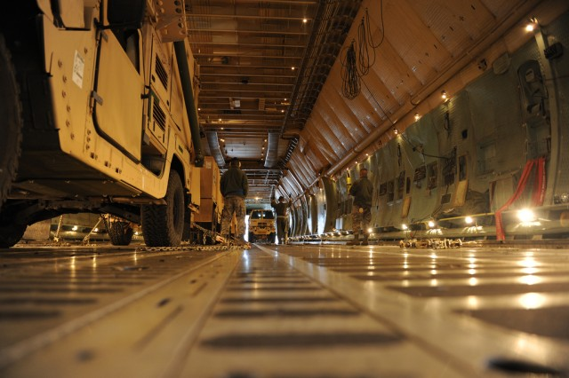 U.S. Air Force personnel load a medium tactical vehicle from U.S. Army Europe's 10th Army Air and Missile Defense Command onto a C5 Galaxy transport plane at Ramstein Air Base, Germany, Jan. 8. The load-up was part of the 10th AAMDC's deployment to Turkey, along with other USAREUR, Army and multinational forces, in support of NATO operations.