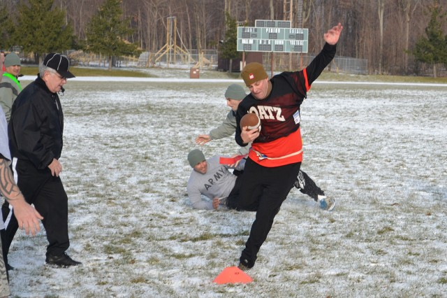 """Lt. Col. Christopher Wendland, commander of 2nd Battalion, 15th Field Artillery Regiment (Allons), strives to stay inbounds during the annual """"Allons Bowl"""" Dec. 13 at Magrath Field."""