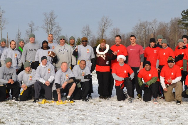 """Officers and NCOs of 2nd Battalion, 15th Field Artillery Regiment (Allons), gather after the annual """"Allons Bowl"""" flag football game Dec. 13 at Magrath Field."""