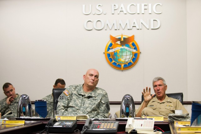 U.S. Navy Adm. Samuel Locklear, Commander of U.S. Pacific Command, briefs Army Chief of Staff Gen. Ray Odierno on current operations at the Pacific Command Headquarters in Camp Smith, HI, Jan. 9, 2013.