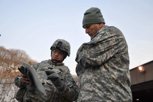 1st Lt. Joshua Sumpter, the Battery B executive officer, 6th Battalion, 37th Field Artillery, 210th Fires Brigade, 2nd Infantry Division, briefs Gen. Raymond T. Odierno, the Army chief of staff, on the MLRS system used by his battery.  Oderino visited 2nd Inf. Div. at Camp Casey, South Korea, Jan. 11, 2013, where he talked with the division Soldiers and viewed their newly accquired equipment.