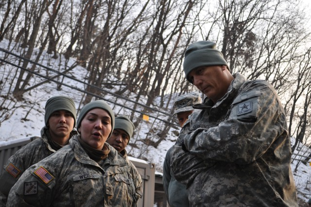 Spc. Leah Weiss, a CBRN specialist with 4th Chemical Company, 1st Brigade Special Troops Battalion, 1st Armored Brigade Combat Team, 2nd Infantry Division, and a Bethlehem, Pa.,-native, talks to Gen. Raymond T. Odierno, the Army chief of staff, about her training experience in Korea.  Oderino visited 2nd Inf. Div. at Camp Casey, South Korea, Jan. 11, 2013, where he talked with the division Soldiers and viewed their newly accquired equipment.