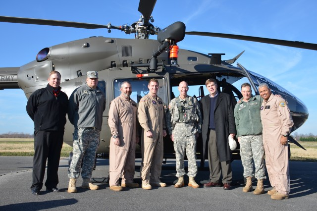 Pilots and crew members of the LUH-72A S&S Mission Equipment Package aircraft pose with Huntsville's Mayor Battle before a demonstration flight on December 14 at the Madison County Executive Airport in Meridianville, Ala.