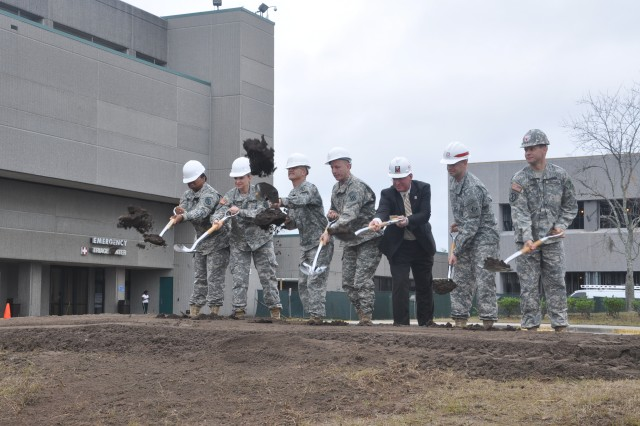 (From left to right) Maj. Yvette McCrea, Lt. Col. Jennifer Wiley, Col. Ronald J. Place, Brig. Gen. John H. Hort, Kevin Kuntz, Maj. Brian Tritten, and Lt. Col. Ross Davidson break ground on phase two of an expansion and renovation project at Winn Army Hospital at Fort Stewart, Ga.