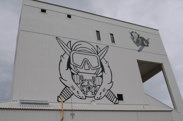 The 50-foot Sgt. Maj. Walter Shumate Free Ascent Dive Tower stands in the center of the Special Forces Underwater Operations School campus in Key West, Fla. The tower was recently painted to feature the Combat Diver insignia, Green Beret and Special Forces insignia, as seen on the tower's side in this photo. (U.S. Army photo by Sgt. Candace Le, 22nd Mobile Public Affairs Detachment)