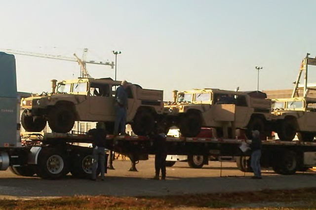 High Mobility Multipurpose Wheeled Vehicles, or HMMWVs, are prepared for transport to Port Aqaba, Jordan in support of a Foreign Military Sales case facilitated by the U.S. Army Security Assistance Command. The vehicles will be used by the Jordan Armed Forces.