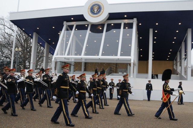 Soldiers rehearsing the inaugural parade march past the reviewing stand, Jan. 13, 2013, in Washington, D.C.