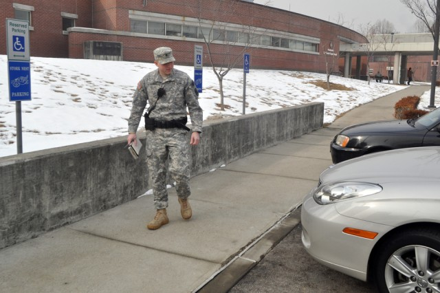 Spc. Robert S. Jones, Traffic Collision Investigator for 142nd Military Police Company, checks out the vehicles parked at the handicapped parking zones of the 121st Combat Support Hospital / Brian Allgood Army Community Hospital for possible violations, Jan. 15. (U.S Army photo by Pfc. Lim Hong Seo)