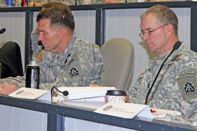 """FORT SAM HOUSTON, Texas """" Lt. Gen. William Caldwell IV, commanding general of U.S. Army North (Fifth Army) and senior commander of Fort Sam Houston and Camp Bullis, (left) along with Command Sgt. Maj. Hu Rhodes, take notes during the Department of Homeland Security/Department of Defense Fiscal 2014 Concept of Support workshop Jan. 9. The workshop brought together military and civilian agencies tasked with providing border security to discuss unified actions of approach to the situation. (U.S. Army photo by Staff Sgt. Corey Baltos, Army North PAO)"""