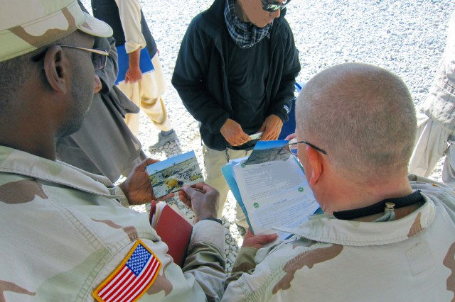 Nick Norals, (left) and Russ Wallace, (right) both real estate specialists with the Afghanistan Engineer District-South meet with Afghan prospective claimants to discuss their real estate situations and determine if their claims are legitimate. The authority to acquire real estate in foreign countries in support of military contingency operations is delegated to the Assistant Secretary of the Army. Authority is further delegated to the U.S. Army Corps of Engineers and at the Afghanistan Engineer District-South, to its experts on the ground, the real estate division chief and his staff.
