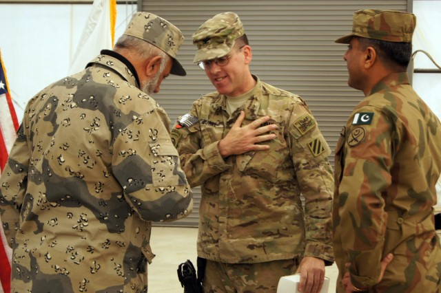 U.S Army Col. John Burke, outgoing director of the Joint Border Coordination Center, greets representatives from the Afghan Border Police and Pakistan army during the JBCC transfer of authority ceremony at Forward Operating Base Spin Boldak, Afghanistan, Jan. 7, 2012. The 27th Infantry Brigade Combat Team from New York Army National Guard relinquished authority to the 208th Army Liaison Team from Fort Carson, Colo.